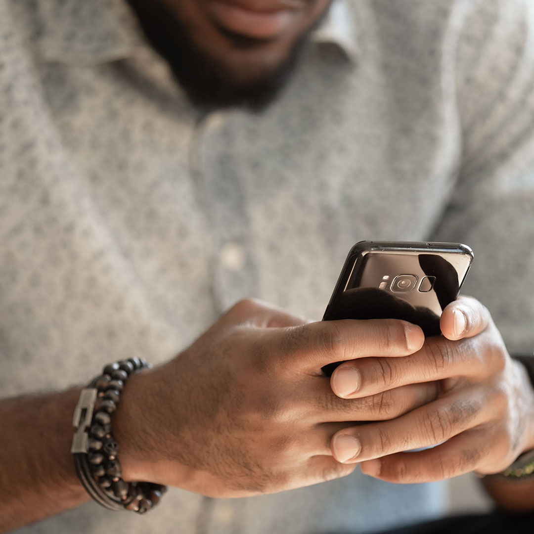 Image of a man on his phone